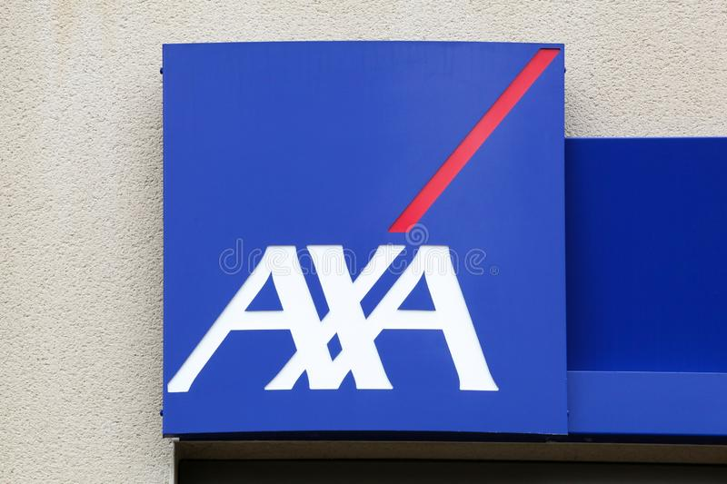 AXA insurance logo on a wall. Peronnas, France - April 7, 2019: AXA insurance logo on a wall. AXA is a French multinational insurance firm that engages in global stock image