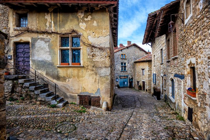 Perouges, a medieval old town near Lyon, France. Cobbled streets of Perouges, a medieval walled old town near Lyon, France, one of the most beautiful villages of stock image
