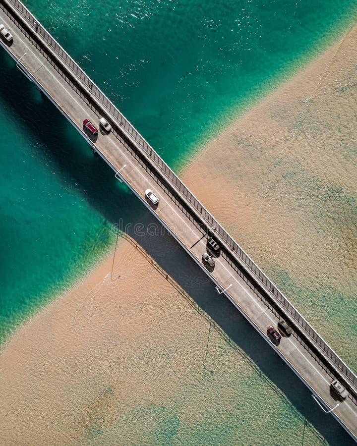 A perpendicular shot of a narrow bridge royalty free stock images
