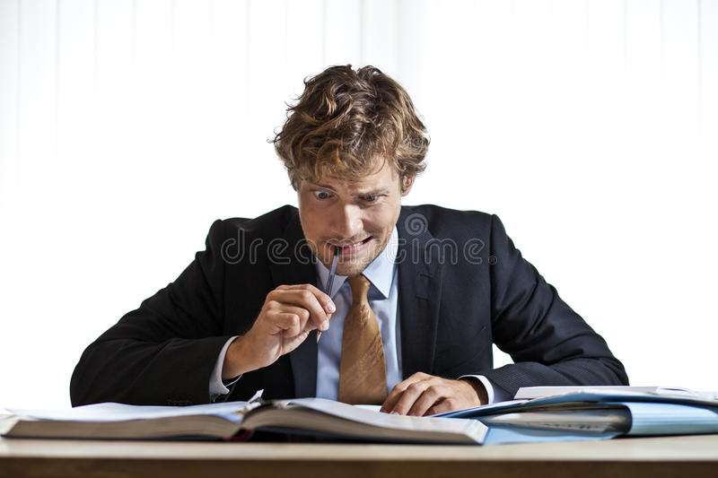 Perplexed businessman working on problem royalty free stock photography