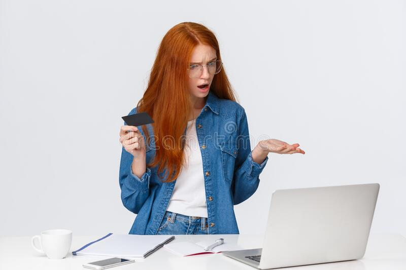 Perplexed and confused redhead woman cant make online purchase, dont know why problem with transferring money occused royalty free stock images
