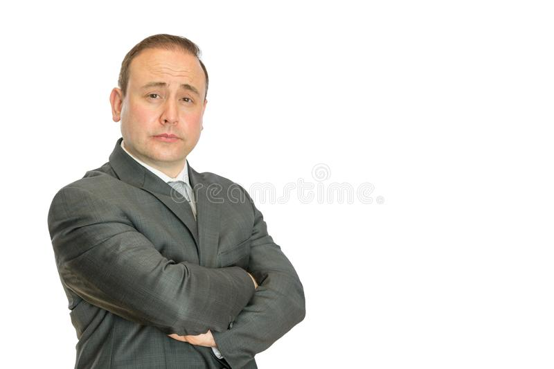 Perplexed, stern businessman with crossed arms stock images