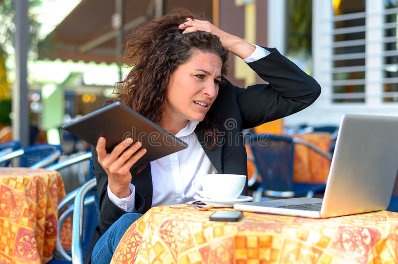 Perplexed stressed young businesswoman royalty free stock photography