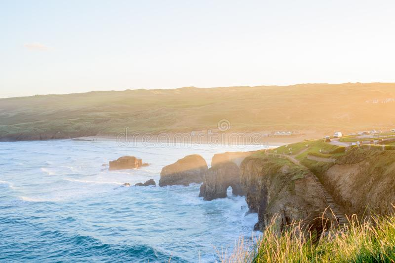 Overlooking Perranporth Beach at perranporth, Cornwall, England, UK Europe during sunrise. Perranporth is a seaside resort town on the north coast of Cornwall royalty free stock photography