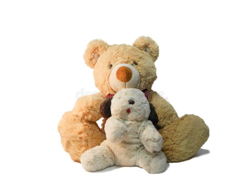 Perrito de la felpa y un oso de peluche imágenes de archivo libres de regalías