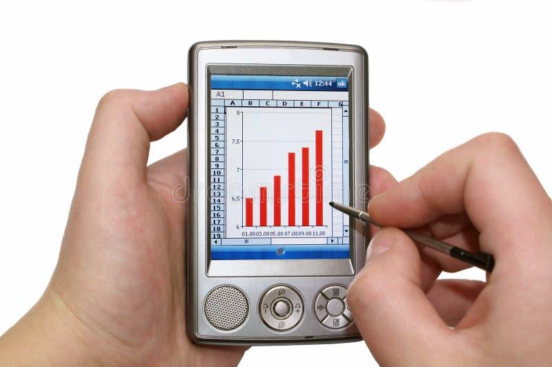 Persönlicher digitaler Assistent in den menschlichen Händen lizenzfreies stockfoto