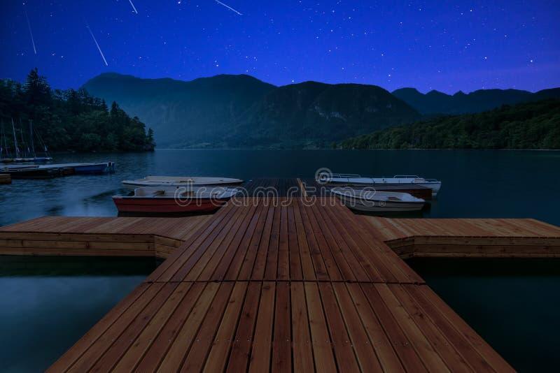 Perseid MEteor Shower at wooden pier at Bohinj Lake, Slovenia royalty free stock image