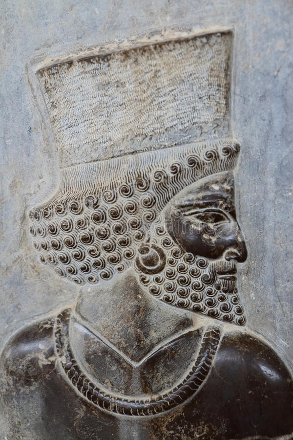 Persepolis-Flachrelief im Stein stockbild