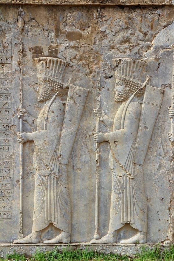Persepolis: Soldaten Carvings stockbilder