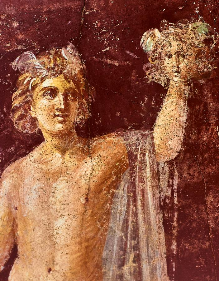 Perseus fresco with the head of Medusa in a Domus of Pompeii stock images
