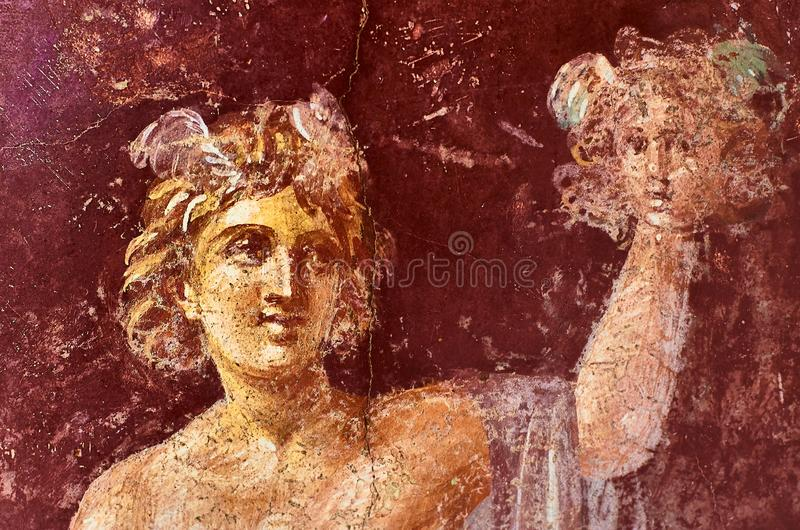 Perseus fresco with the head of Medusa in a Domus of Pompeii stock photos