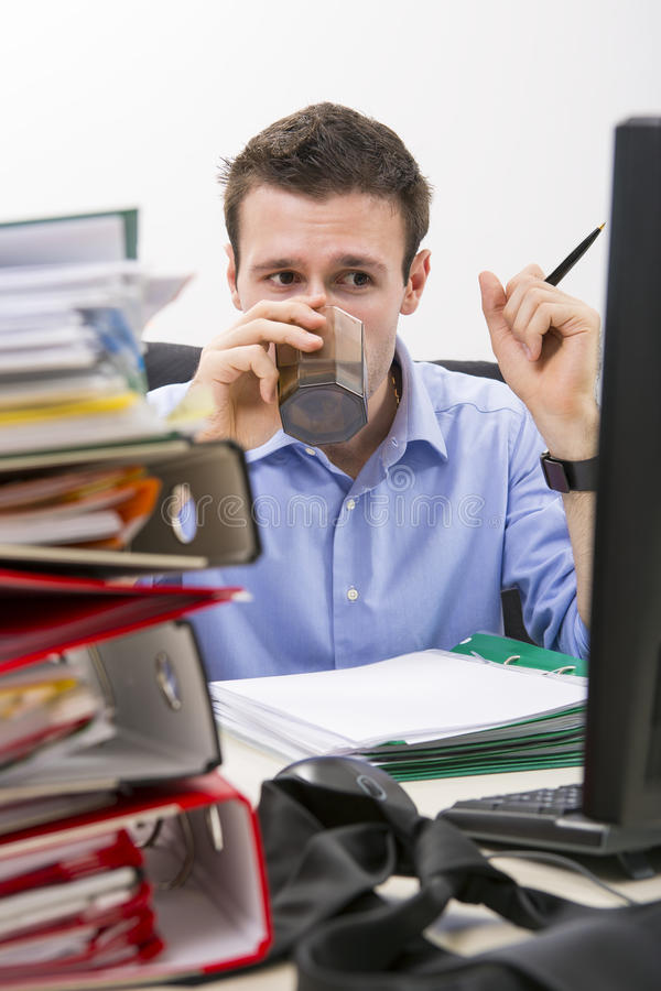 Perseverant businessman at work royalty free stock images