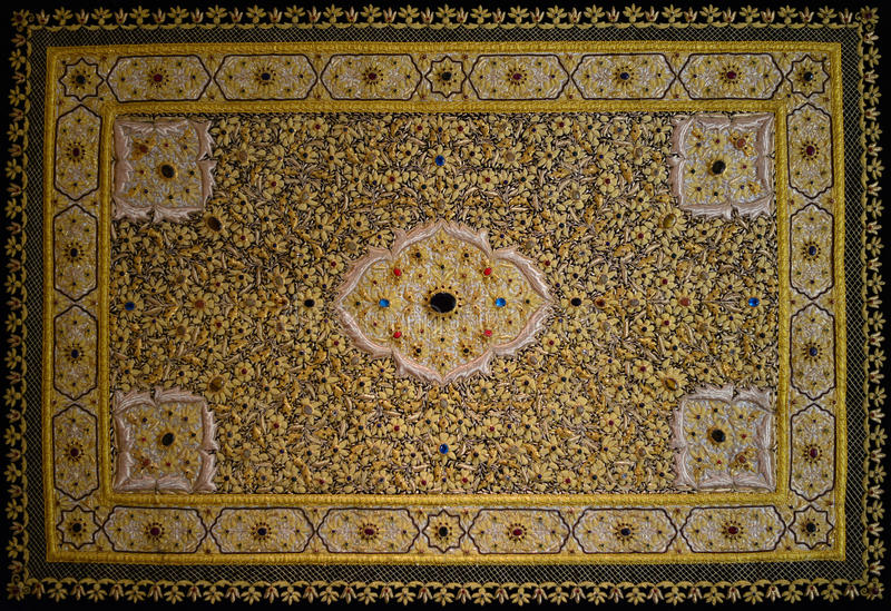 Persian Carpet. With golden ornaments and gemstones royalty free stock photo