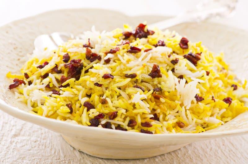 Persian Saffron Rice with Berberis. As closeup un a white plate stock photos