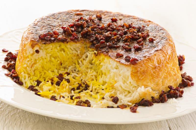 Persian Saffron Rice with Berberis Sereshk Polo. As closeup on a white plate stock photos