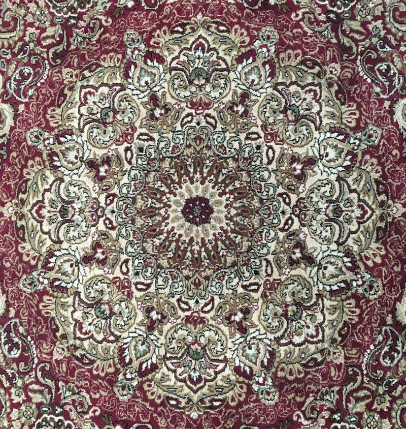 Persian style rug design - circular red carpet. Beautiful and colourful Persian style rug, red with intricate design royalty free stock image