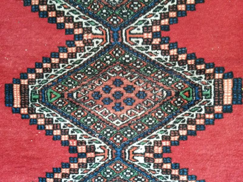 Persian or Turkmen oriental rug Carpet middle east stock photography