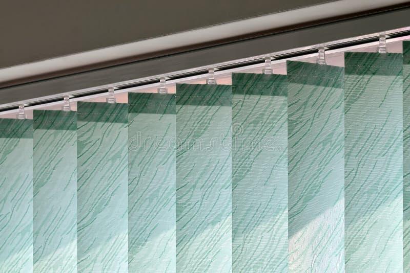 Persianas modernas de la vertical en la ventana imagen de archivo libre de regalías