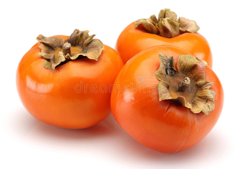 Persimmon. Fruits on white background stock images