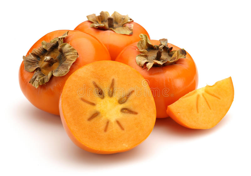 Persimmon. Fruits on white background royalty free stock photography