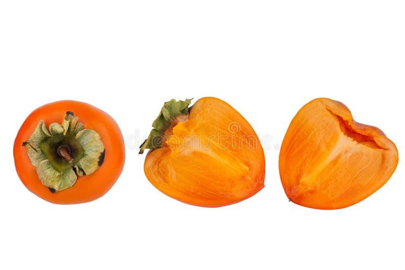 Persimmon lub Sharon owoc z zielenią opuszczamy jeden cały i jeden cięcie w dwa połówkach na biały tło odizolowywającym zakończen zdjęcia royalty free