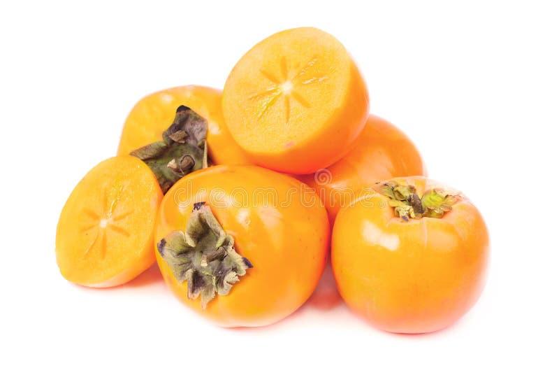 Persimmon owocowy cały, pokrojony i fotografia stock