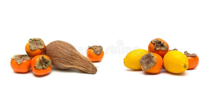 Persimon, kokosnöt och citron som isoleras på vit bakgrund royaltyfria bilder
