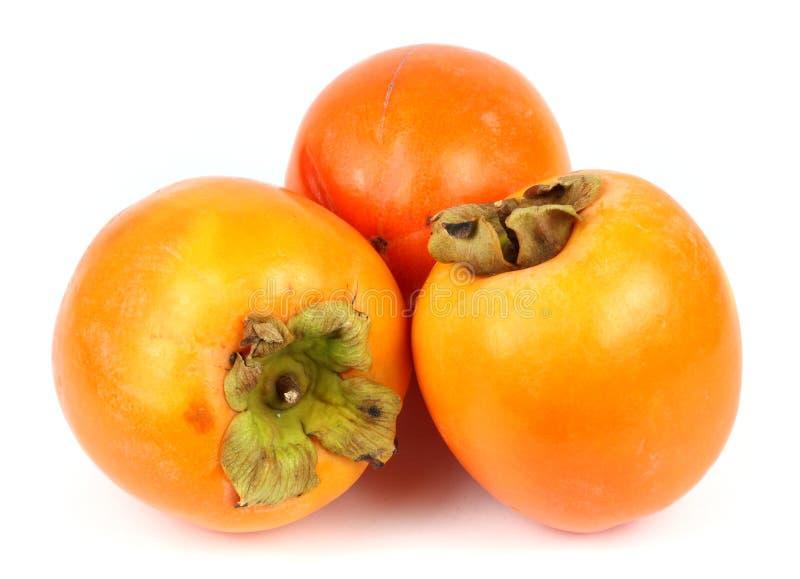 Persimonfrukt på vit bakgrund royaltyfria bilder