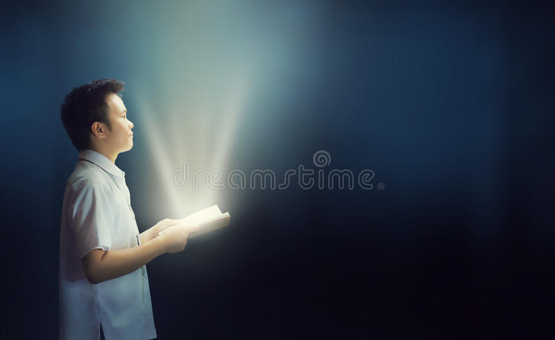 Persistent Reading in the dark with flashlight. royalty free stock images