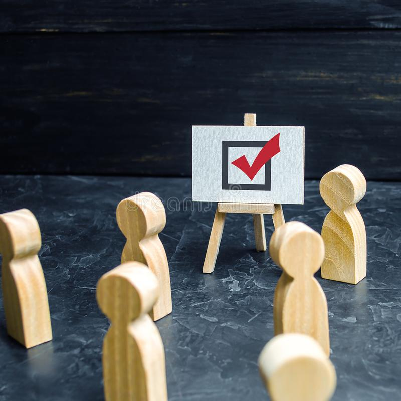 A person agitates people and employees to vote in an election or referendum. Political race, problem solving, propoganda. Business royalty free stock image