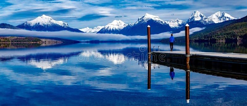 Person by an Alpine lake stock photo