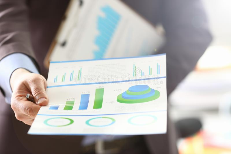 Person Analyzing Business Proceeds Using Graph royalty free stock images
