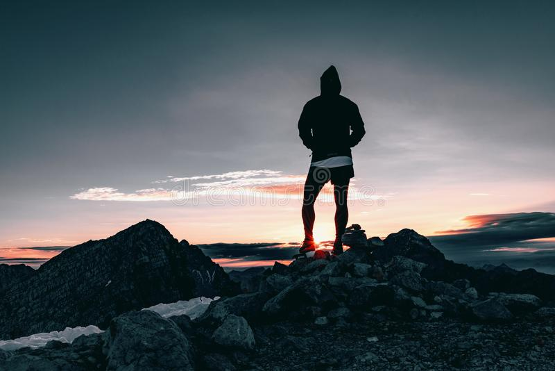 Person In Black Hoodie Standing On Rocks During Dusk Free Public Domain Cc0 Image