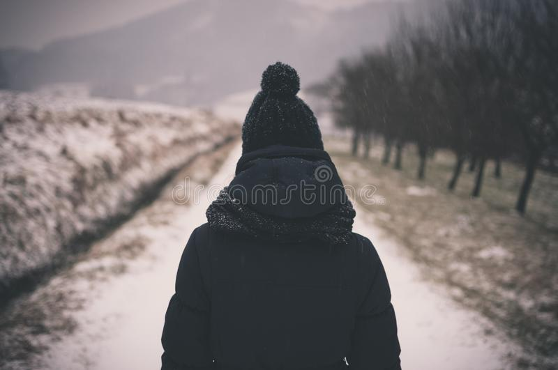 Person In Black Knit Cap About To Walk In Grey Empty Pathway During Daytime Free Public Domain Cc0 Image
