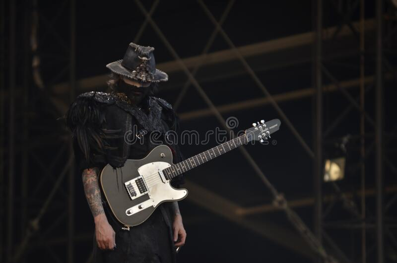 Person In Black Shirt With A Black Telecaster Guitar Free Public Domain Cc0 Image