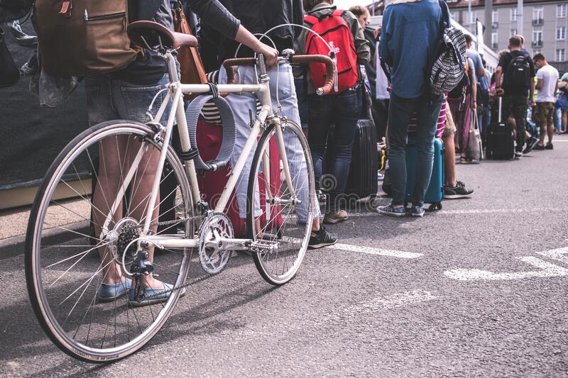Person in Black Sweater Hold a Grey Road Bike stock photo