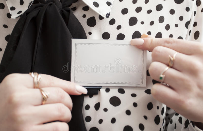A person with a blank name tag stock images
