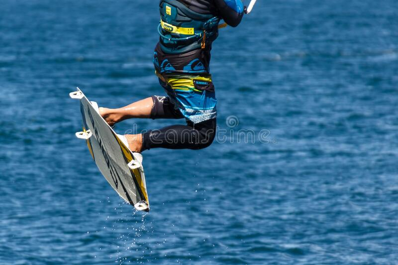 Person in Blue and Black Board Shorts on White Wake Board royalty free stock images
