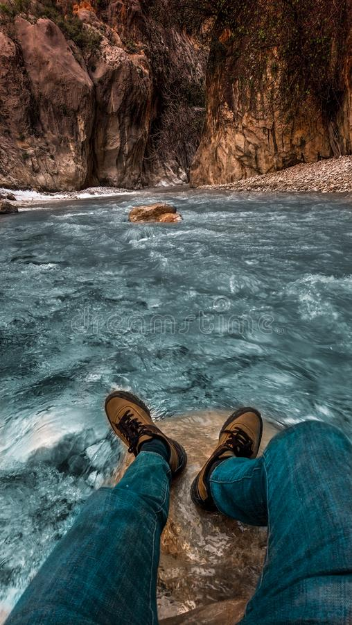 Person In Blue Jeans And Brown Sneaker Near Body Of Water Free Public Domain Cc0 Image