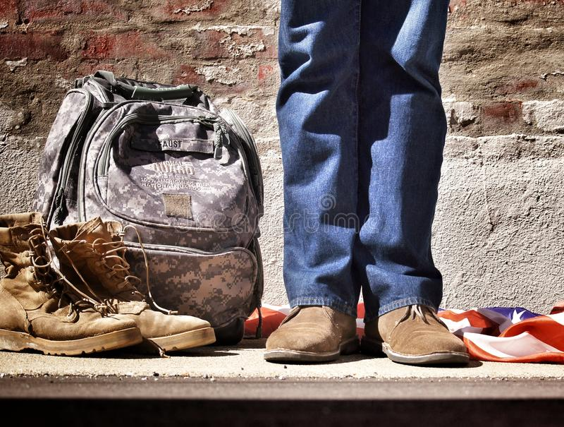 Person In Blue Jeans And Brown Suede Shoes Standing Near Camouflage Backpack Brown Hiking Boots And American Flag On Floor Free Public Domain Cc0 Image
