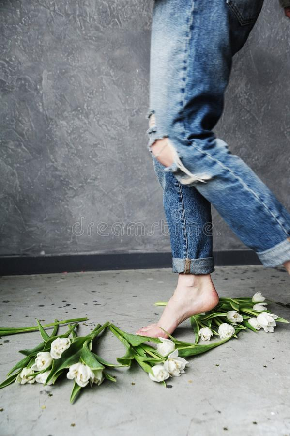 Person in Blue Ripped Jeans royalty free stock image