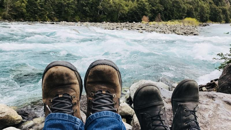Person in Brown Boots Near Body of Water at Daytime royalty free stock image