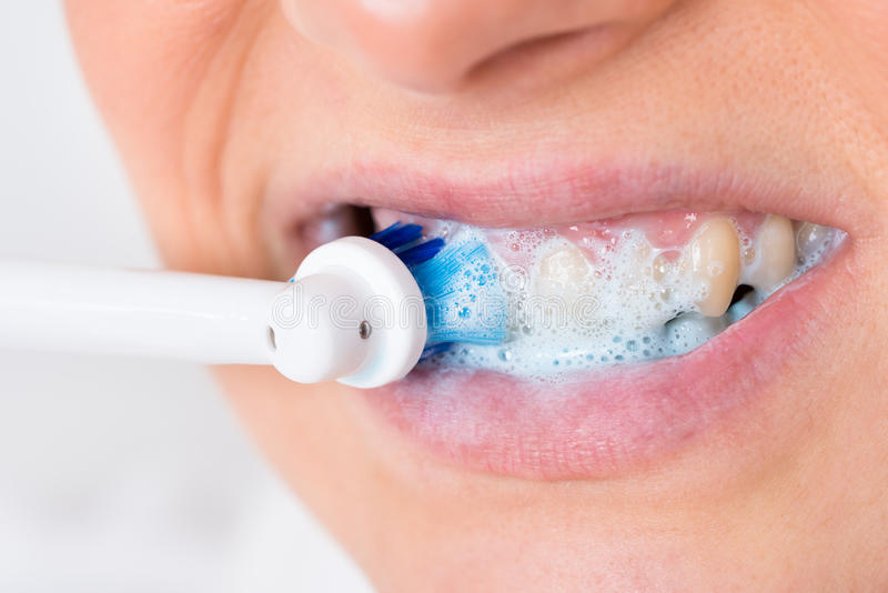 Person brushing teeth royalty free stock photography