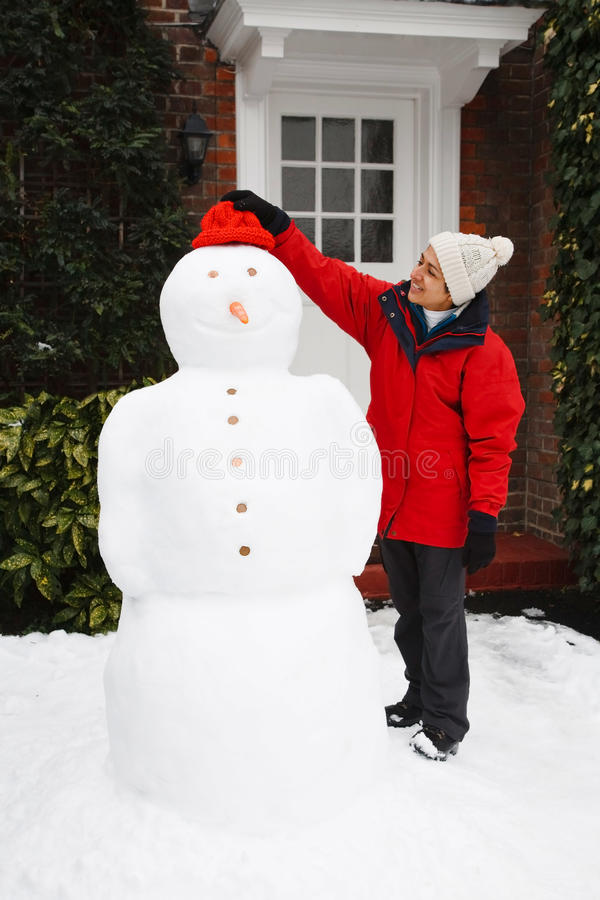 Person building snowman royalty free stock photos