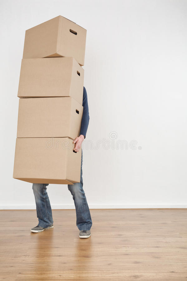 Person Carrying Moving Boxes immagini stock