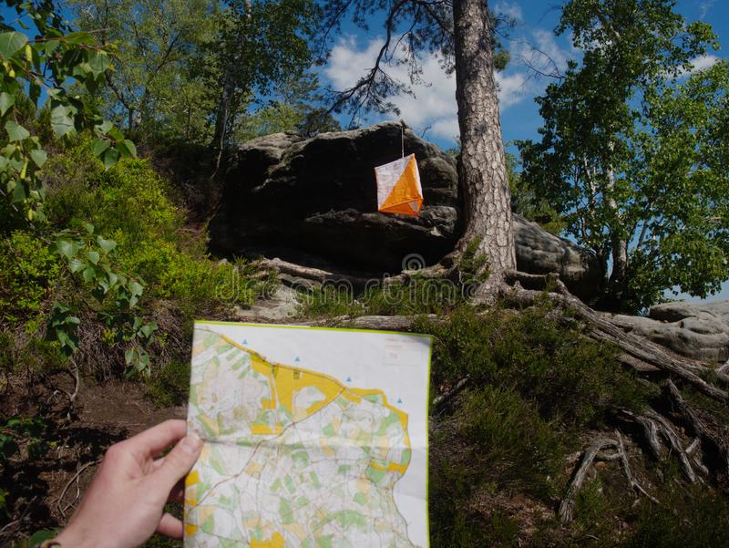 Person check the map within orienteering run.  Difficult terrain. Person check the map within orienteering run.  Sportsman running in difficult rocky terrain stock photo