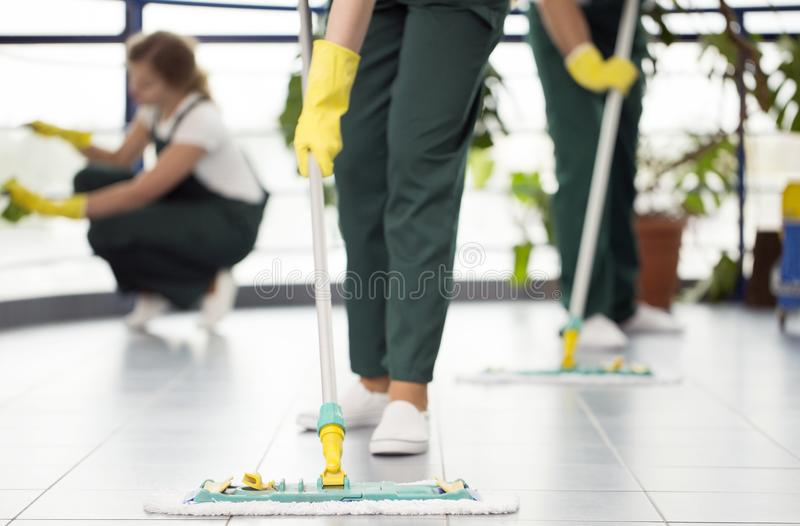 Person cleaning the floor stock photography