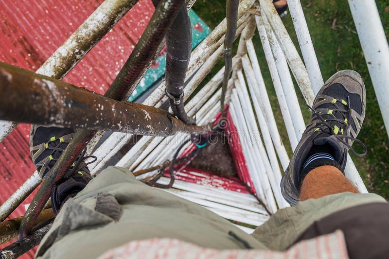 Person climbing a triangular guyed lattice mast near Santa Elena village, Costa Ri royalty free stock photos