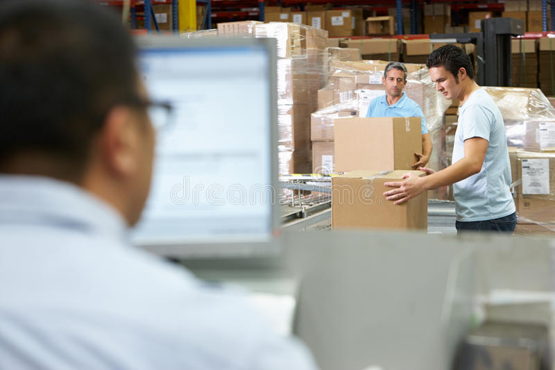 Download Person At Computer Terminal In Distribution Warehouse Stock Image - Image of person, computer: 29350707