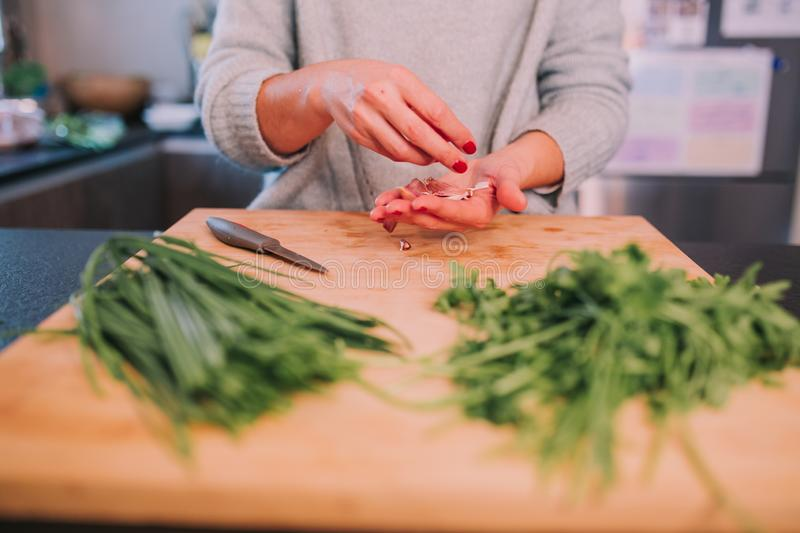 A person is cooking vegetables royalty free stock image